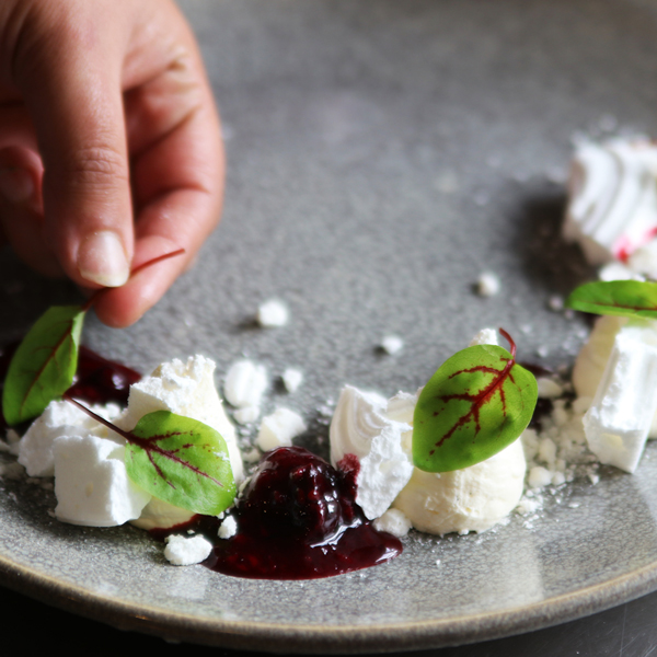 Our chef putting together a delicate meringue dessert