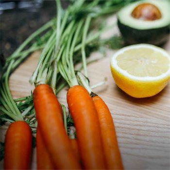Fresh carrots on a chopping block