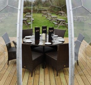 At dining dome set up for six guests